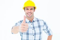 Architect showing thumbs up over white background Stock Images