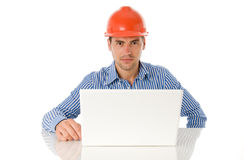 Architect sitting with laptop Royalty Free Stock Photography