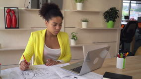 Architect with sketch on desk pc. stock footage