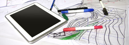 Architect sketches with markers, pens and tablet. Architect working space with papers, markers, pens and tablet royalty free stock photos