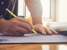Architect sketching a construction project blueprint Royalty Free Stock Images
