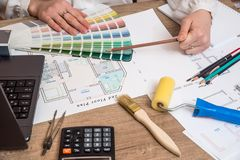 Architect sketching a construction project with laptop, color palette. And work tools royalty free stock image