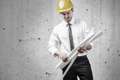 Architect sorting plans Stock Photo