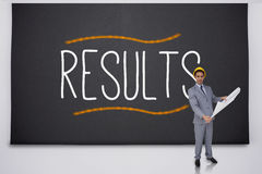 Architect standing against results Royalty Free Stock Photos