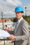 Architect standing on building site Royalty Free Stock Images