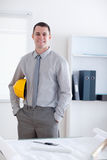 Architect standing and carrying a helm Stock Photography