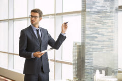 Architect standing giving a presentation Royalty Free Stock Images