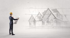 Architect standing with house plan stock images
