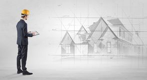 Architect standing with house plan Stock Photo