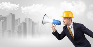 Architect standing and yelling to far big city panorama royalty free stock photo