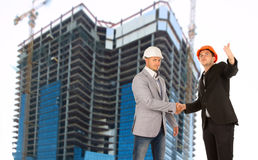 Architect and structural engineer shaking hands Royalty Free Stock Images
