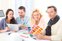 Architect students choosing colors for their project Royalty Free Stock Photography