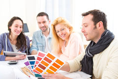 Architect students choosing colors for their project Royalty Free Stock Photos
