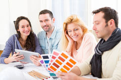 Architect students choosing colors for their project Stock Photos