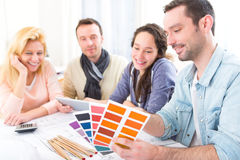 Architect students choosing colors for their project Royalty Free Stock Image