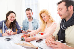 Architect students finalysing their house construction project Royalty Free Stock Photos