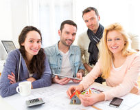Architect students finalysing their house construction project Royalty Free Stock Image