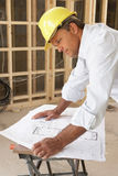 Architect Studying Plans. In New Home Stock Photo