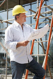 Architect Studying Plans Outside Royalty Free Stock Images