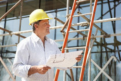 Architect Studying Plans Outside Stock Photography