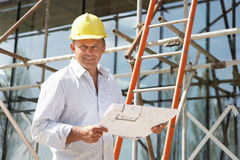 Architect Studying Plans Outside Stock Image