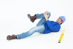 Architect suffering from knee pain. After falling against white background Royalty Free Stock Photography