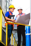 Architect and supervisor on construction site Stock Photos