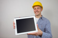 Architect with a tablet pc. An architect with a tablet pc Royalty Free Stock Image