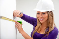 Architect taking measurements Royalty Free Stock Photo