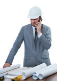 Architect talking on call phone at work place. Royalty Free Stock Photo