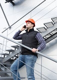 Architect talking on phone while inspecting factory Royalty Free Stock Photos