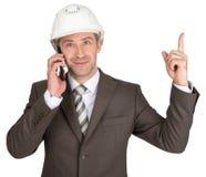 Architect talking on phone and raising finger up Stock Images