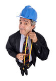 Contractor. With a blue hardhat holding a yellow tape measure - isolated on white royalty free stock image