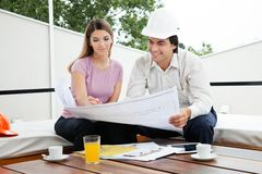Architect Team Discussin House Plans royalty free stock photography