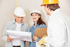 Architect team planning with floorplan. In cooperation for success royalty free stock images