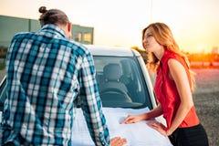 Architect team reading blueprint on car hood royalty free stock photos