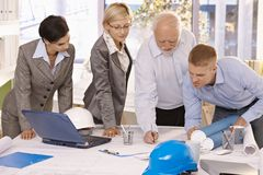 Architect team working together in office Stock Images