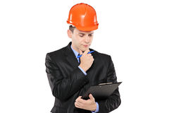 An architect in thoughts holding a clipboard Stock Photo