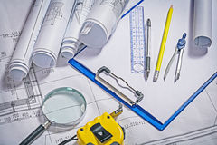 Architect tools blueprints cipboard magnifer ruller Stock Photography