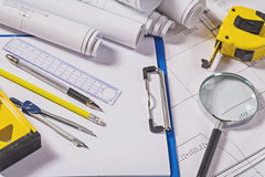 Architect tools on blueprints Royalty Free Stock Photo
