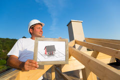 Architect on top of a brand new family house Royalty Free Stock Photo