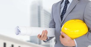 Architect Torso holding a cask and plans in the street Stock Photography