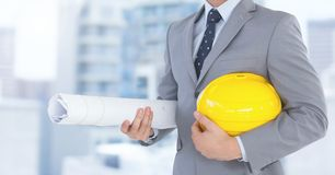 Architect Torso holding plans in the street royalty free stock image