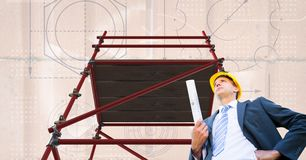 Architect under 3D scaffolding with  bricks background. Digital composite of Architect under 3D scaffolding with  bricks background Stock Image