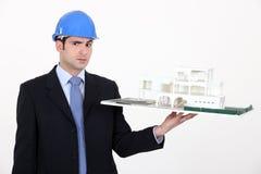 Architect unsure about a design. Architect unsure about a building model royalty free stock photos