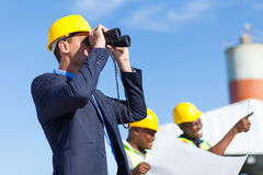 Architect using binoculars Stock Images