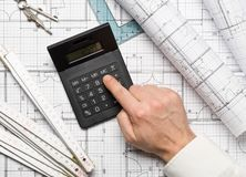 Architect Using Calculator On Architectural Blueprint House Building Plan With Pencil, Ruler, Compasses And Square Flatlay Stock Images