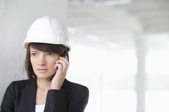 Architect Using Cell Phone In Empty Warehouse Stock Photography