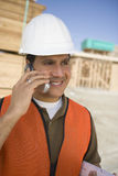 Architect Using Cell Phone At Site Stock Image