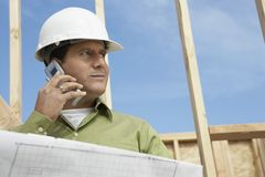 Architect Using Cellphone At Construction Site Royalty Free Stock Photography